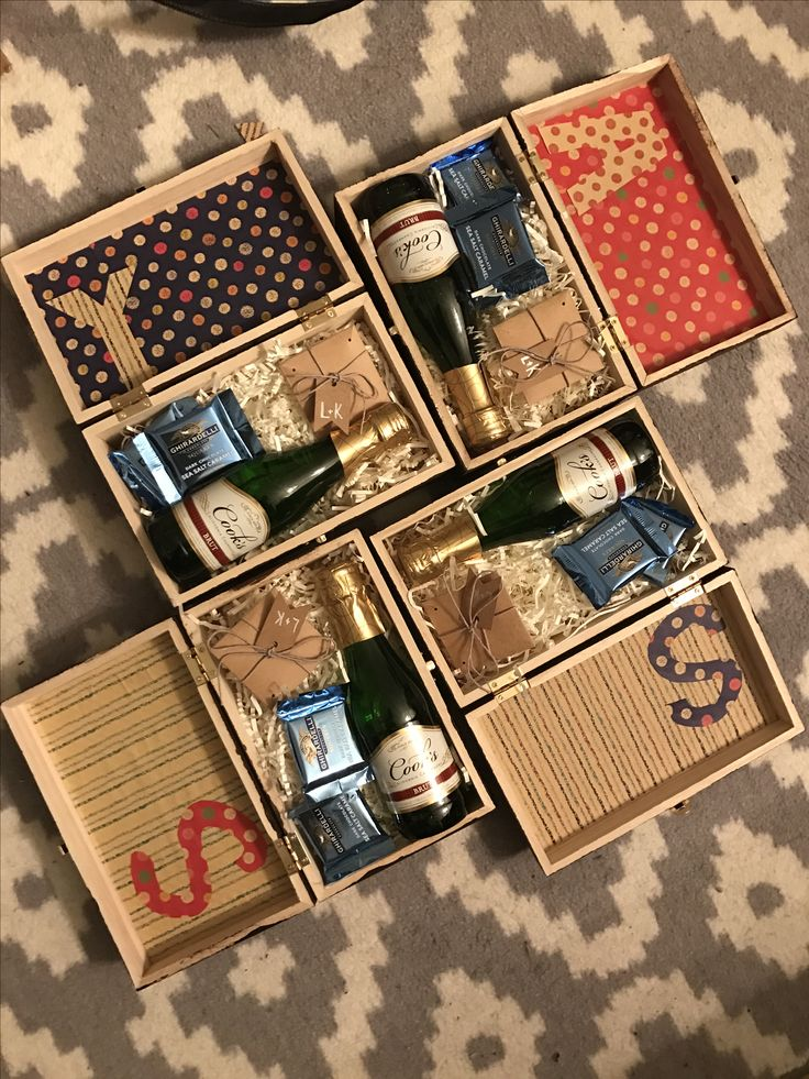 Homemade bridesmaids gift boxes. Champagne. Candy. Handmade jewelry. Painted.
