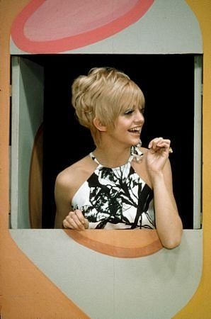 Goldie Hawn on Laugh-In - The Joke wall on Laugh-In. I loved how they would still be performing even when the closing credits were rolling. Jokes right up the the very last second !