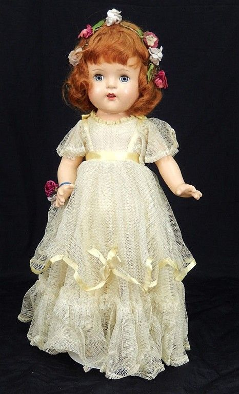 "Madame Alexander Princess Elizabeth composition doll, all original, near mint, blue glass sleep eyes, applied upper lashes, painted lower lashes, eyebrows, open mouth with upper teeth, marked on head ""Princess Elizabeth, Alexander Doll Co"", wearing yellow taffeta dress, underwear, socks, and shoes, flowers in hair and on wrist, 17"" tall"