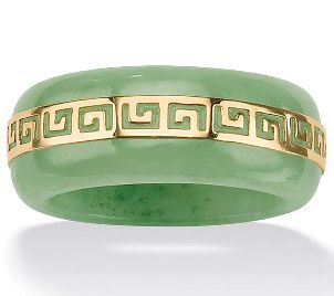 A beautiful green jade ring with a gold Greek design
