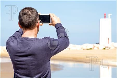 Man Photographing With Smartphone #Featurepics