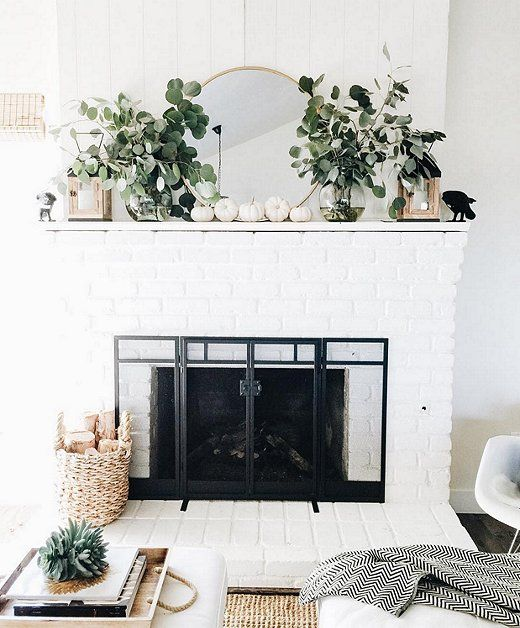 Love the texture and height from the eucalyptus bunches on this festive fireplace mantel.
