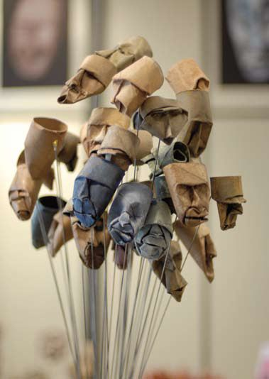 Toilet Paper Roll Faces Artwork - these are displayed at the face height on that thin wire... they are pretty interesting. Junior Fritz Jacquet is the artist