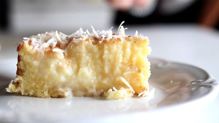 Brazilian Coconut Cake video instructions: A cake with a rich coconut base and grated coconut topping.