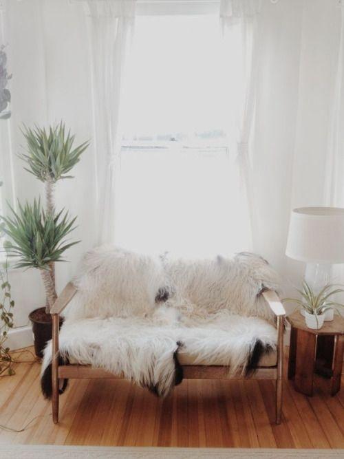 Bohemian/simple living room, white shag blanket or throw, house plants and wooden floors.   foodforflowersblog.com