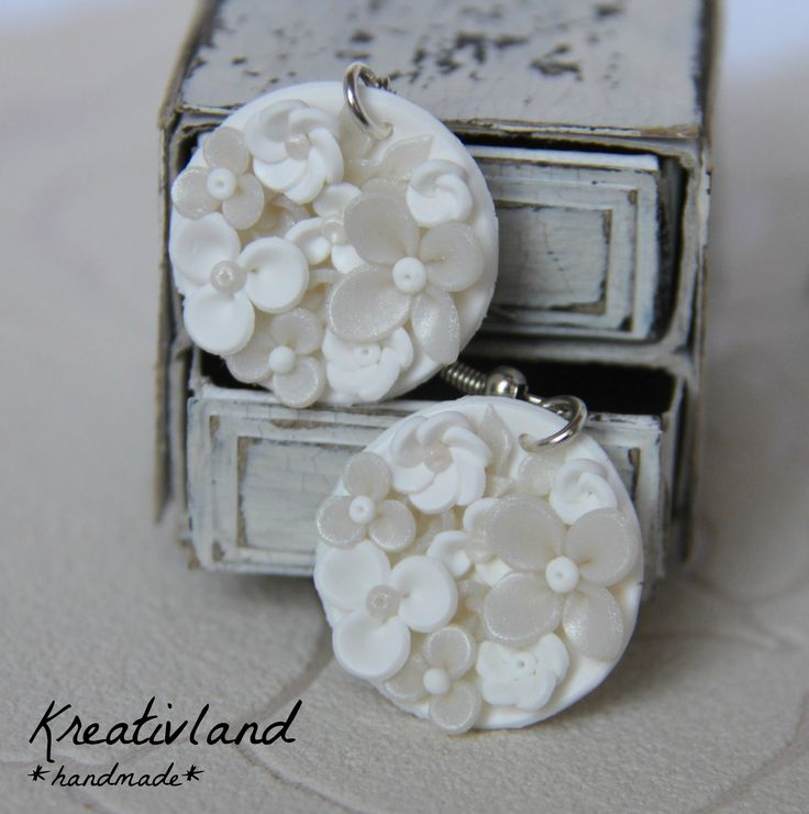 *Potpourri #2* Bowl shaped earrings filled with a lot of flowers in plain and white colours.