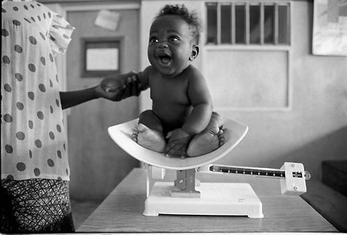 Ugandan baby being weighed for the first time at the hospital.