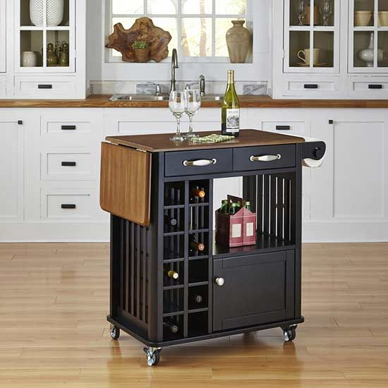 We've all been dreaming a massive kitchen island, sitting perfectly in the center of a gourmet kitchen, but we can't all be granted such wishes. Many of us need to maximize our storage space with a functional kitchen island that won't take up too much room. Get excited, because we have found some stylish picks that grant all your kitchen wishes.