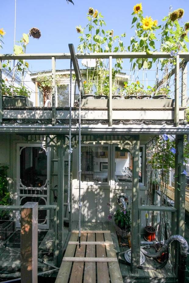 """Visitors to Ms. Maguire's floating home stroll down a private walkway, then cross a gangplank to step aboard. """"It has a lot of lovely charac..."""