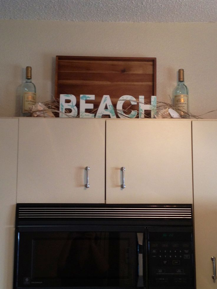 Beach Decorating Idea For Above The Kitchen Cabinets