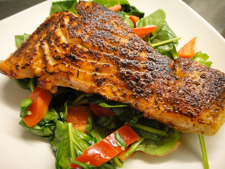 Sauteed salmon with Tom Douglas' salmon rub from Etta's Seattle, over sauteed spinach and red pepper with minced garlic and cilantro