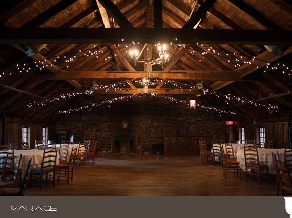 I'd love a space like this for the comfy contrast of the rustic, natural materials with the romance of the lights & candles, and elegant wedding touches.  :)