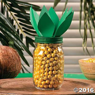 Pineapple Candy Jar   Create a tropical centerpiece your guests can grab candy out of! Easy to craft, this eye-catching candy jar centerpiece is great for your next backyard luau or tropical office party.  1. Paint the lid of a mason jar green and let dry. 2. Using green paper cut out about 6-7 oval shaped leaves. 3. Glue the leaves onto the painted mason jar lid. 4. Fill the jar up with yellow candy. 5. Put the lid on with the candy inside.