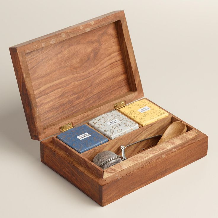 Our exclusive British tea service set includes English Breakfast, English Afternoon and Earl Grey loose-leaf teas packed inside a handsome wood storage chest with an intricate, hand-carved design. A fantastic gift for tea aficionados and beginners alike, this affordable set includes a tea infuser and a wooden stirring spoon.