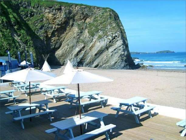 Lusty Glaze Beach Wedding Reception Venue in Newquay, Cornwall. Lusty Glaze Beach is one of Cornwalls hidden gems, the horseshoe cove is surrounded by 135ft cliffs creating an idyllic setting to get married.