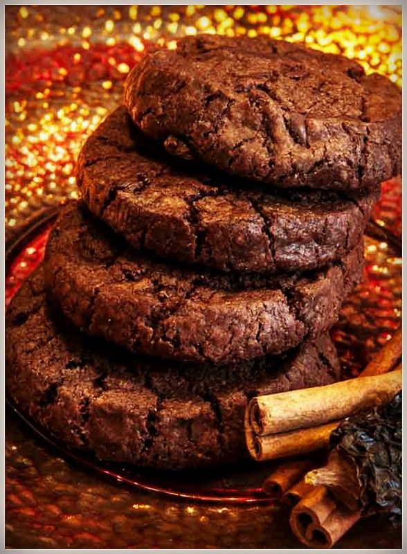 Chocolate Molé Cookies kick with authentic Mexican molé sauce made of smoked chipotle peppers, vinegar, herbs, spices—and cinnamon! With every bite, the heat builds. You then wash these chiquitas down with cold milk, iced coffee, or a bottle of Dos Equis.