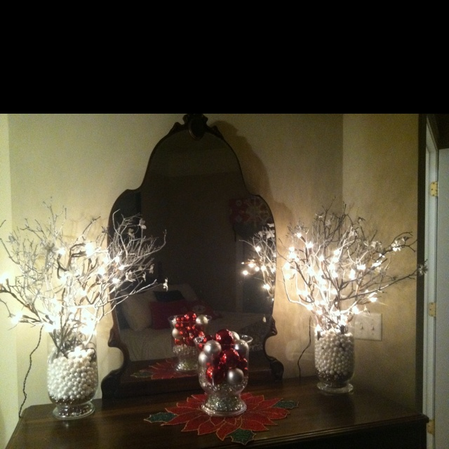 spray painted branches with lighted branches in decorative decanters
