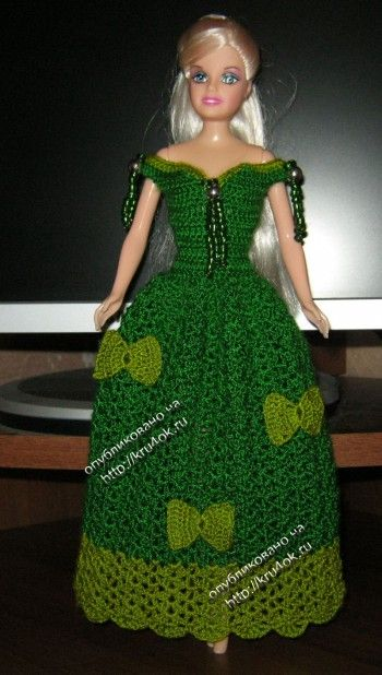 Miss Barbie is ready for the holidays in this green dress with diagram