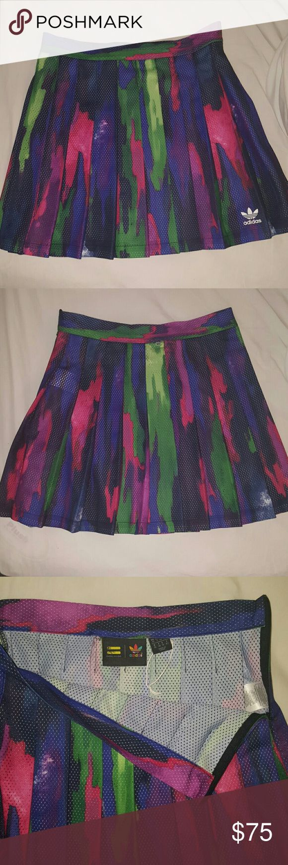 Pharrel for Adidas Camouflage Tree Skirt Pharrel Williams for Adidas Multi Colored Camouflage Skirt  Womens sized small  Has A-line sports cut This is brand new with no tags Adidas Skirts A-Line or Full