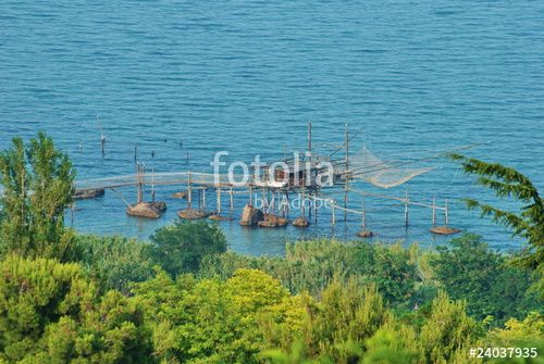 View over a Trabocco, an old fishing machine typical of the coast of Abruzzi region, Italy - #trabocco #trabucco #fishingmachine #costadeitrabocchi #abruzzo #vasto #typical #italy #unesco