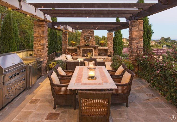 ~ Living a Beautiful Life ~ Craftsman Patio with Trellis, exterior stone floors, outdoor pizza oven, Pompeii 7-piece Wicker Dining Set, Outdoor kitchen