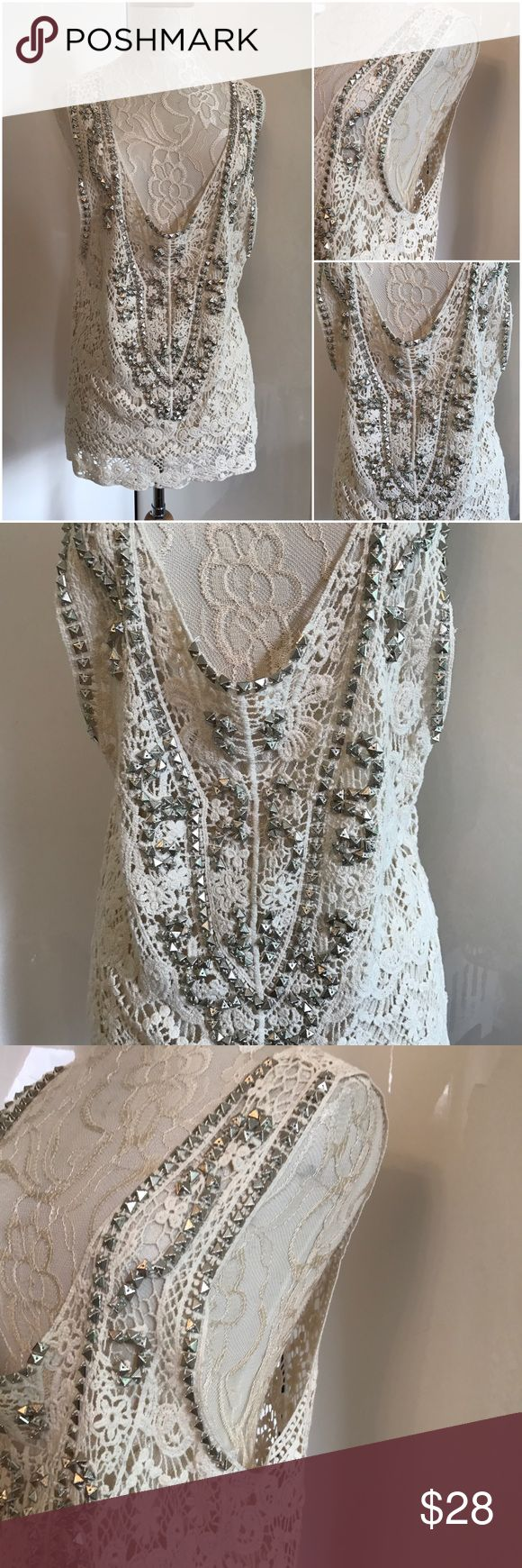 NWOT Lace Tunic Top Oversized sz L Longer style Lace top with details. Oversized style. Will look great over a tank top or over a swimsuit. It's off white in color. New without tags. Size Large. Tops