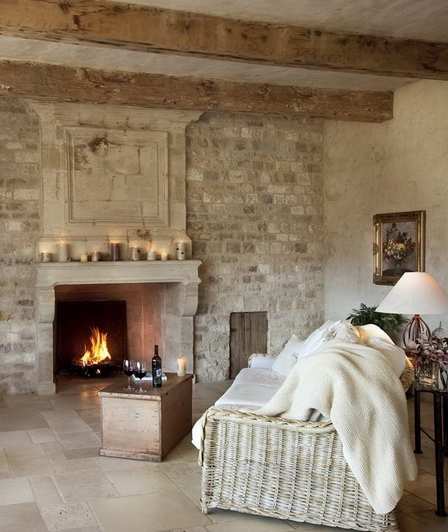 Gorgeous! ...but all I see are head injuries waiting to happen... Beautiful limestone floor, original beams & stone fireplace.