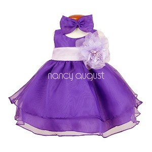 This sassy purple organza layered baby dress features a sensational sleeveless style with a triple layer skirt. This beautifully simple organza tea length dress comes with a a adjustable sash tie in the back. Like many of our special occasion dresses, it is versatile and can be used as a flower girl dress, pageant dress, or even as a holiday party dress. No matter the occasion, this will make your little flower girl even more adorable. You can even add a detachable flower for the waistline!
