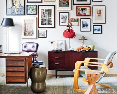 Loving the mixture of wooden mid-century furniture and a perfectly balanced art collection