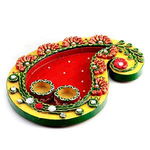 Exquisite pooja thaali in keri design wood and clay work studded with kundans. Costs Rs 655/- http://www.tajonline.com/gifts-to-india/gifts-AR5239.html?aff=pinterest2013/