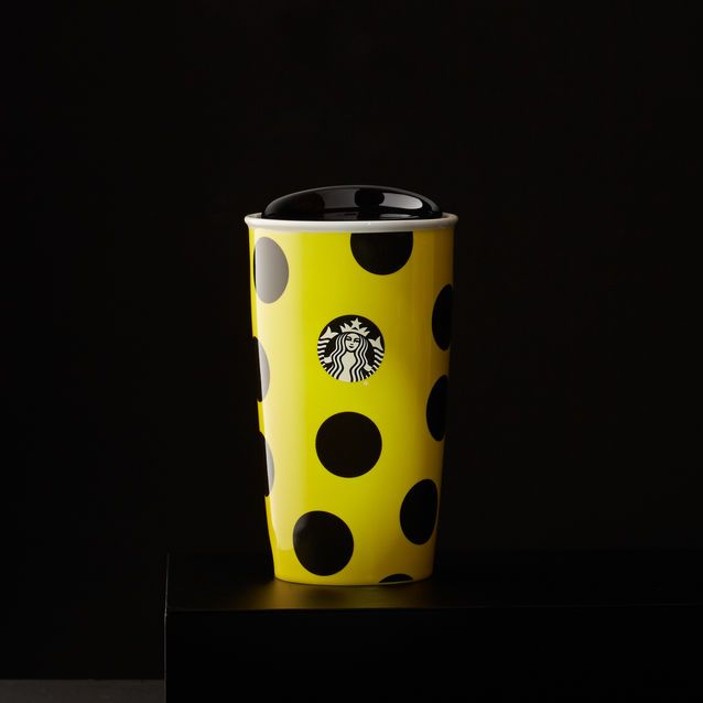 A+double-walled+ceramic+mug+featuring+a+dot+pattern+and+yellow+body.+Part+of+the+Dot+Collection.