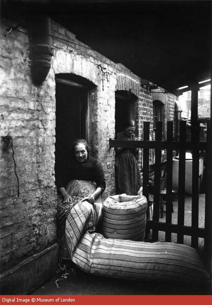 Making mattresses from home using straw - She would receive 1 shilling for each completed mattress 1900s-East End