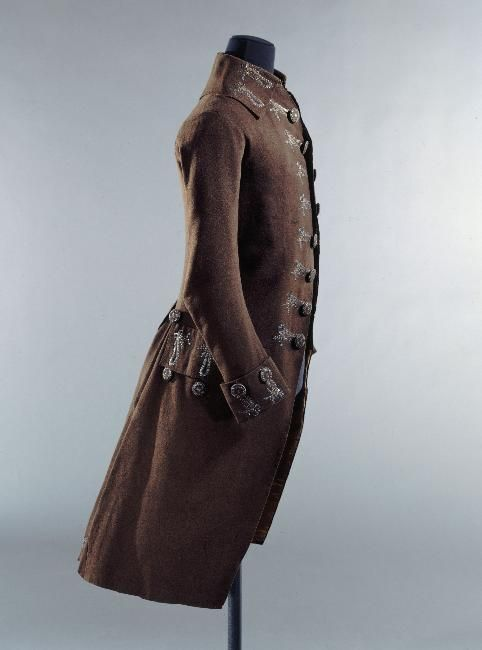 Coat, 1785-1789. Brown wool, embroidered with gold blackened silk thread, cream wool lining.