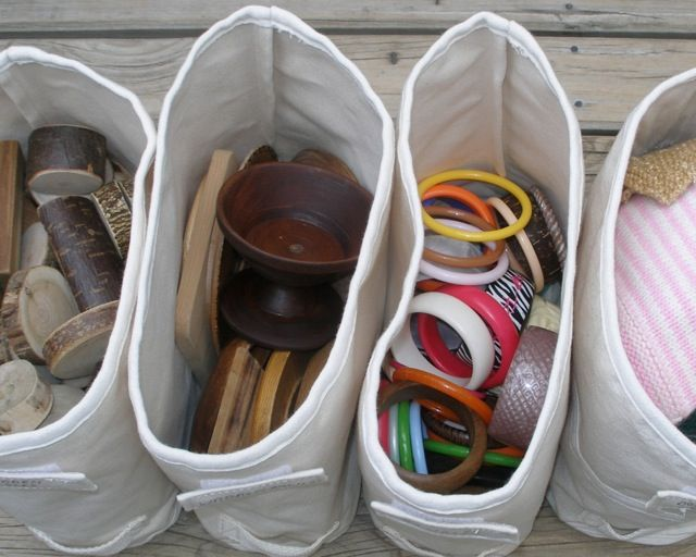 blocks, wooden containers, bangles, dolls' blankets - in labelled rectangular shelf storage containers