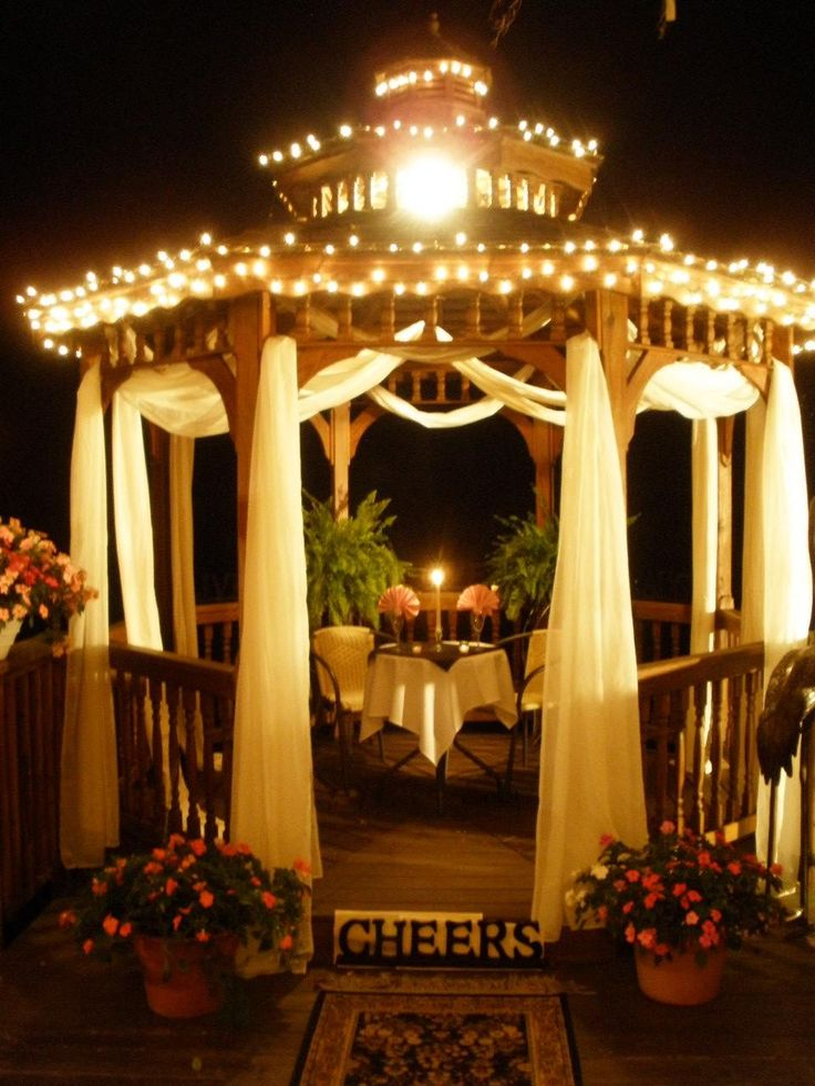Gazebo with drapery and Christmas lightning. How romantic is that!