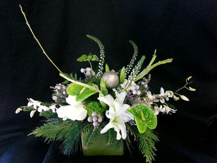 Green and white floral arrangement $85 Grafe Studio Floral Artists  Everett Warnock