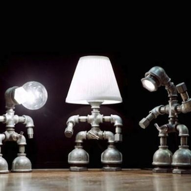 Scrap Metal Art - Ordinary plumbing parts—pipes, fittings, and faucets—come together to make robot table lamps full of personality and charm. Turn one on and you suddenly don't feel so alone in the room.