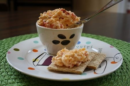 Chobani pimento cheese    8 oz. block mild cheddar, shredded  6 oz. container plain Chobani (0%)  4 oz. jar diced pimentos, drained  juice from 1/4 lemon  1/2 tsp red pepper flakes (or more, to taste)  Shred cheese using a grater (or use preshredded if you