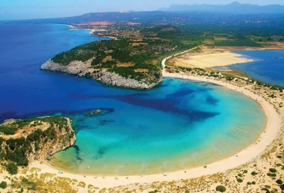 This omega-shaped beach will cater to all your eye candy needs! #Pylos, #Peloponnese, #Greece