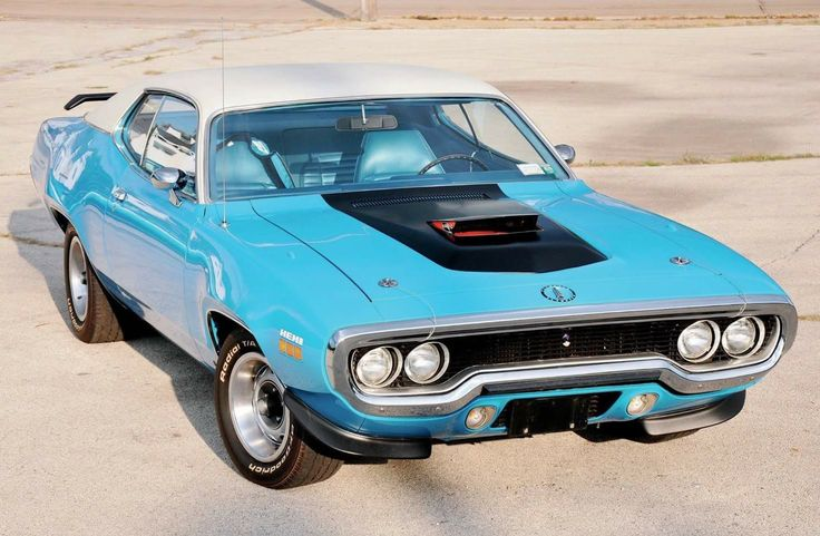 "1971 Plymouth Road Runner in ""Petty Blue"" with a white vinyl roof."
