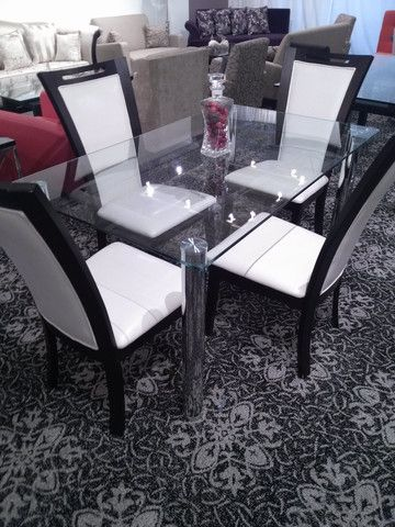 This glass and chrome rectangular Dining Table is a beautiful and modern addition to any home. It is very sleek and stylish.      Features:  Contemporary style Tempered glass Chrome finished legs Table 35''x59''x30'' White PU leather Dining Chairs Chair 20''x18''x41'' Cappuchino Finish