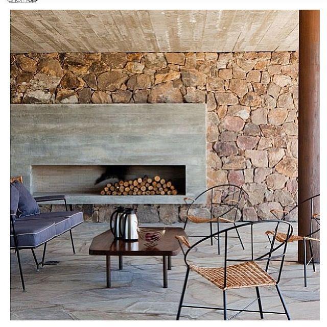 Rustic modern #fireplace -- concrete + stone.