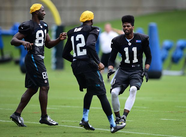 WRs Jason Avant (81), Tavarres King (12) and Tiquan Underwood (11) practice a special team's drill during practice on Tuesday, August 19, 2014