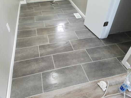 Confer a long-lasting touch of ceramic-like style to your home decor using  this TrafficMASTER Ceramica Coastal Grey Vinyl Tile Flooring.