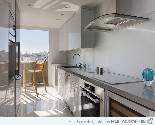 Check out these modern high-gloss grey kitchen designs!  20 Astounding Grey Kitchen Designs | Home Design Lover