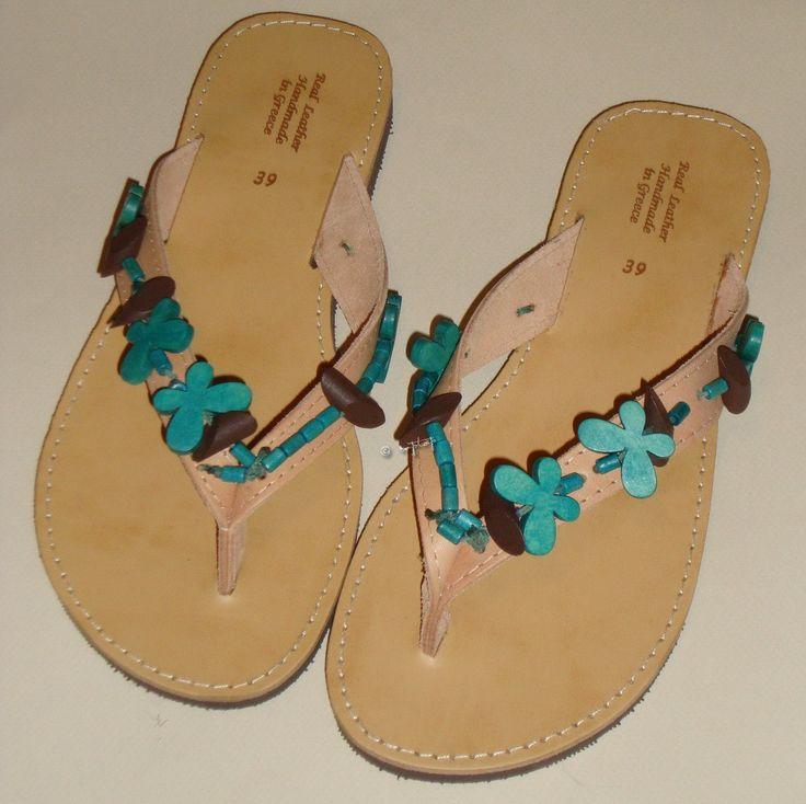 Leather sandals hand-decorated with turquoise wooden butterflies
