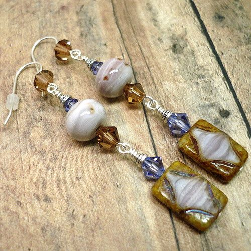 """These distinctive long earrings of Czech table cut glass, Swarovski crystals and artisan crafted lampwork are perfect for the discerning woman who loves unique jewelry.  The overall make of these earrings contains two handmade links which I have named """"Painted Earth"""".  For the first link I used sleek and smooth handcrafted lampwork glass beads  made using opaque Painted Desert Odd glass by Vetrofond. This is a gorgeous streaky color that is unique and whimsical as a desert breeze an..."""