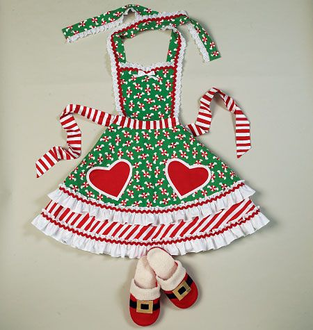 Gift idea to sew for the hostess who really gets into the Christmas spirit. McCall's M6860, Aprons, Oven Mitts, Hat, Slippers, and Table Leg Decorations