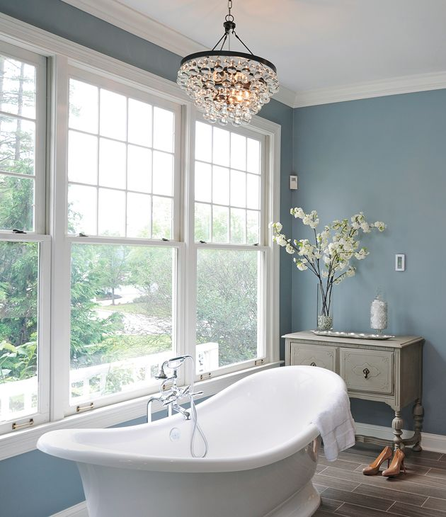 Elegant Light Fixtures And Old Fashioned Faucets Create A Soothing Bathroom Retreat In This Columbus