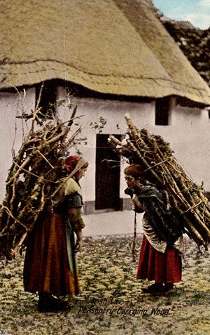 """Irish life, peasant carrying wood"""